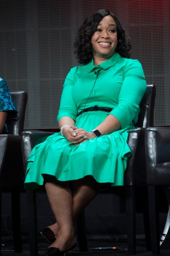 Shonda Rhimes smiling while sat on chair on stage